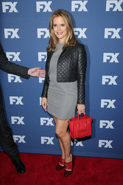 Kelly Preston teamed her dress with a quilted black leather jacket.