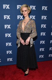 Sarah Paulson went flirty in this Philosophy di Lorenzo Serafini combo dress, featuring a black lace skirt and a printed bodice with a deep-V neckline, for the 'People v. O.J. Simpson: American Crime Story' screening.