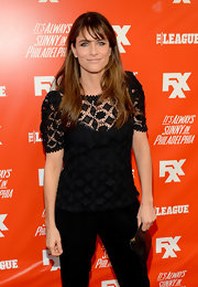 Amanda Peet looked conservative in a black lace blouse during the FXX Network launch.