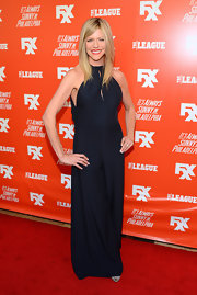 Kaitlin Olson chose a stylish navy halterneck jumpsuit for her red carpet look during the FXX Network launch.