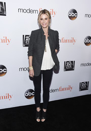 Julie Bowen topped off her outfit with a gray blazer.