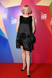 Gwendoline Christie was vintage-chic in a rosette-embellished LBD at the UK premiere of 'In Fabric.'