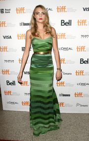 Cara Delevingne flaunted her supermodel physique in a striped green slip dress during the premiere of 'The Face of an Angel.'