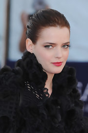 Roxanne paired her fur embellished frock with a sleek bun.