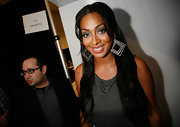 La La Anthony wore an eye-catching pair of dangling geometric earrings to the Falguni & Shane Peacock fashion show.