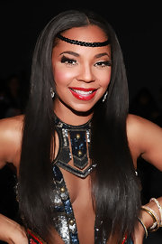 Ashanti wore a vivid red lipstick with a shiny finish at the Falguni & Shane Peacock fall 2012 fashion show.