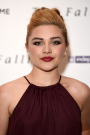 Florence Pugh finished off her makeup with a swipe of glossy red lipstick.