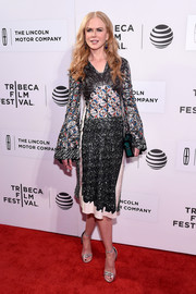 Nicole Kidman added more shimmer with a pair of silver evening sandals, also by Louis Vuitton.