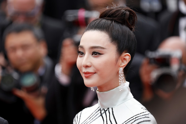 Fan Bingbing Hair Knot [hair,hairstyle,beauty,fashion,eyebrow,chin,lip,street fashion,chignon,smile,red carpet arrivals,fan bingbing,amant double,cannes,france,cannes film festival,premiere,palais des festivals]
