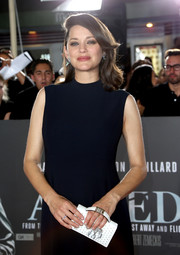 Marion Cotillard arrived for the 'Allied' fan event carrying an embroidered white hand-strap clutch by Dior.