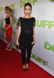 Sarah Hyland repeated the sheer motif with a pair of black mesh cap-toe pumps.