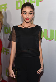 Sarah Hyland attended the fan screening of 'The Duff' carrying a stylish black and gold hard-case clutch by Edie Parker.