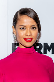 Gugu Mbatha-Raw polished off her glamorous look with a pair of diamond chandelier earrings.