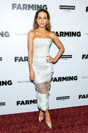 Kate Beckinsale was svelte and elegant in a strapless white dress with a sheer panel on the skirt at the New York screening of 'Farming.'