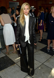 Rachel Zoe totally got into a '70s mood with this flared black leather jumpsuit from her own label when she attended the Fashion Awards 2016 official nominees announcement.