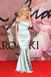Pixie Lott styled her dress with a bejeweled purse and a matching tiara.