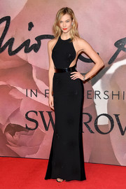 Karlie Kloss flaunted her supermodel physique at the Fashion Awards 2016 in a figure-hugging black Stella McCartney gown with starburst beading and illusion sides.