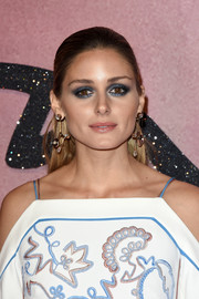 Olivia Palermo topped off her look with modern diamond chandelier earrings.