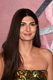 Giovanna Battaglia wore her long hair down in a straight, center-parted style at the Fashion Awards 2016.