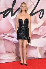 Amber Valletta looked totally party-ready at the Fashion Awards 2016 in a black Saint Laurent sequin dress with a plunging sweetheart neckline.