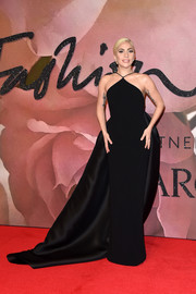 Lady Gaga looked downright glam at the Fashion Awards 2016 in a black Brandon Maxwell halter gown with a flowing train.