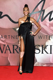 Winnie Harlow complemented her dress with strappy swirl-print pumps.