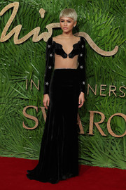 Zendaya Coleman looked daring at the Fashion Awards 2017 in a black Vivetta velvet gown with an illusion bodice and star-embellished sleeves.
