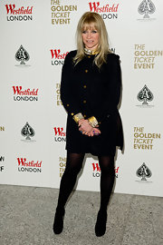 Gold cuffs, collar and buttons gave Jo Wood's black shirtdress an instant lift at a store opening in London.