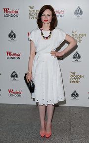 Sophie Ellis-Bextor kept her eyelet frock girlish with the addition of suede coral pumps with pink platforms.