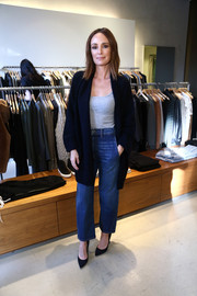 Catt Sadler topped off her outfit with a long black cardigan.