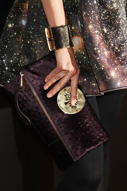 Claudia paired her futuristic dress with a satin clutch with gold hardware.
