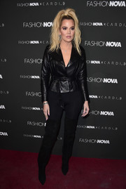 f87700f491e16 Khloe Kardashian sealed off her edgy look with black thigh-high boots.