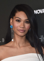 Chanel Iman wore her hair down and straight with a deep side part at the Fashion Nova x Cardi B collaboration launch.