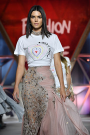 Kendall Jenner walked the Fashion for Relief runway wearing a 'Child at Heart' tee over a glamorous gown.