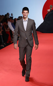 Top-ranked tennis star Novak Djokovic looked sharp while walking the runway for the 'Fashion for Relief' fashion show.