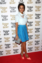 Michelle Keegan paired her blouse with a pleated blue mini skirt by Georgia Hardinge.