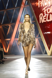 Natasha Poly showcased her supermodel legs in a heavily embellished gold mini dress by Atelier Versace at the Fashion for Relief runway show.