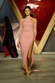 Isabeli Fontana was minimalist-modern in a high-slit, asymmetrical pink dress on the Fashion for Relief runway.