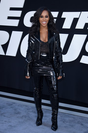 June Ambrose looked hot in a black fur moto jacket layered over a lace cami at the premiere of 'The Fate of the Furious.'