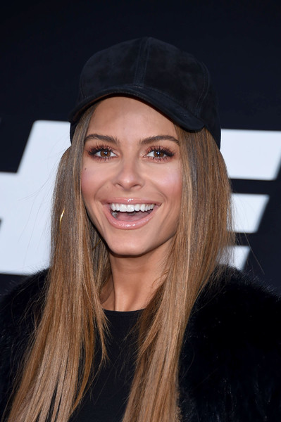 Maria Menounos attended the premiere of 'The Fate of the Furious' looking sporty in a black suede baseball cap.