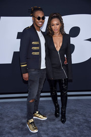 Serayah McNeill rounded out her edgy look with black PVC boots.