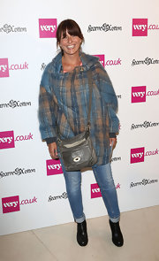 Davina McCall looked a little grungy in a baggy plaid wool coat, skinnies, and boots at the Very.co.uk collection launch.