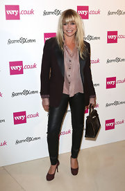 Skinny black leather pants showed off Jo's slim pins at a Fearne Cotton fashion launch in London.