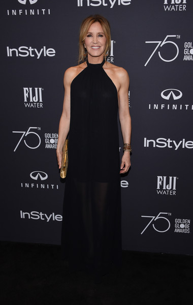 Felicity Huffman Halter Dress [photo,dress,clothing,little black dress,fashion,shoulder,premiere,cocktail dress,carpet,neck,event,felicity huffman,chris delmas,catch la,west hollywood,hollywood foreign press association,instyle,golden globe awards,celebration,season]