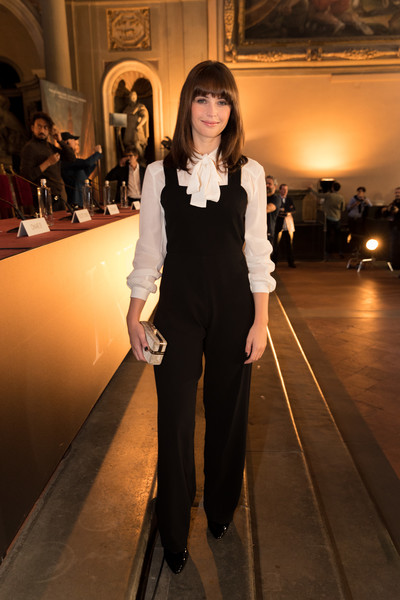 Felicity Jones Beaded Clutch [inferno photo,fashion,fashion model,clothing,suit,haute couture,fashion show,runway,formal wear,pantsuit,fashion design,felicity jones,the hall,italy,florence,press conference,inferno photo call press conference]