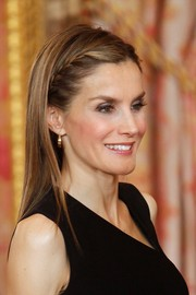 Princess Letizia looked charming wearing her hair down with braided bangs at the Principe de Asturias Foundation meeting.