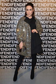 Tallulah Harlech showed her glam side with a sparkly evening coat and matching clutch at the Fendi runway show in Milan.