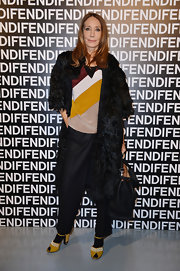 Marisa Berenson glammed up her look at the Fendi runway show with a black fur coat.