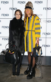 Anna dello Russo brightened up the Fendi fashion show in a fur-striped yellow and gray coat from the brand.