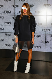 Anna dello Russo completed her offbeat look with a pair of white mid-calf boots by Fendi.